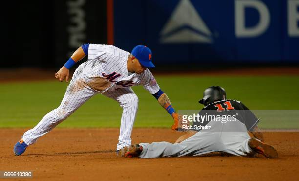 Shortstop Asdrubal Cabrera of the New York Mets tags out JT Realmuto of the Miami Marlins attempting to steal second base during the third inning of...