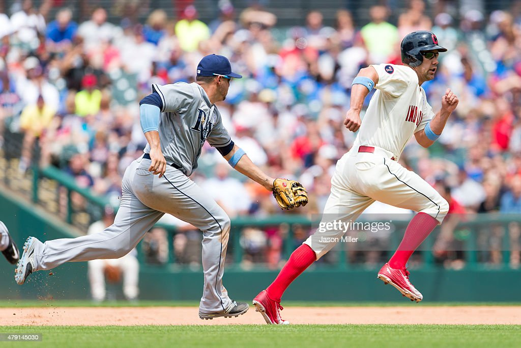 Shortstop <a gi-track='captionPersonalityLinkClicked' href=/galleries/search?phrase=Asdrubal+Cabrera&family=editorial&specificpeople=834042 ng-click='$event.stopPropagation()'>Asdrubal Cabrera</a> #13 of the Tampa Bay Rays tags <a gi-track='captionPersonalityLinkClicked' href=/galleries/search?phrase=David+Murphy+-+Baseball+Player&family=editorial&specificpeople=4604222 ng-click='$event.stopPropagation()'>David Murphy</a> #7 of the Cleveland Indians on a rundown to end the seventh inning at Progressive Field on June 21, 2015 in Cleveland, Ohio.
