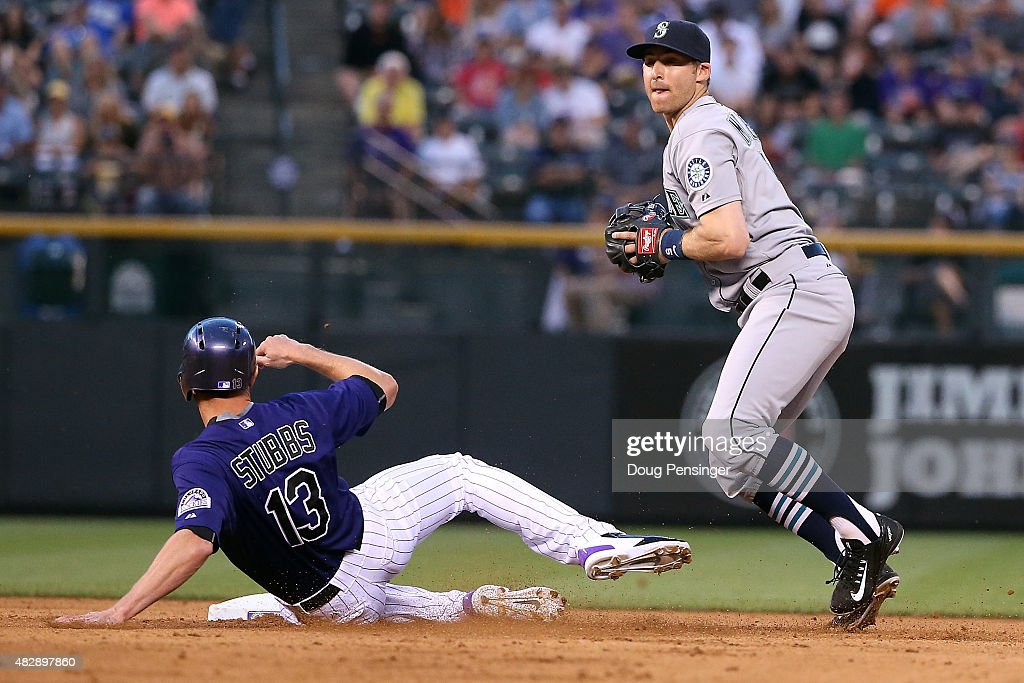 Shortstop <a gi-track='captionPersonalityLinkClicked' href=/galleries/search?phrase=Brad+Miller+-+Baseball+Player&family=editorial&specificpeople=14752161 ng-click='$event.stopPropagation()'>Brad Miller</a> #5 of the Seattle Mariners gets a force out on <a gi-track='captionPersonalityLinkClicked' href=/galleries/search?phrase=Drew+Stubbs+-+Baseball+Player&family=editorial&specificpeople=4498334 ng-click='$event.stopPropagation()'>Drew Stubbs</a> #13 of the Colorado Rockies during interleague play at Coors Field on August 3, 2015 in Denver, Colorado. The Mariners defeated the Rockies 8-7.
