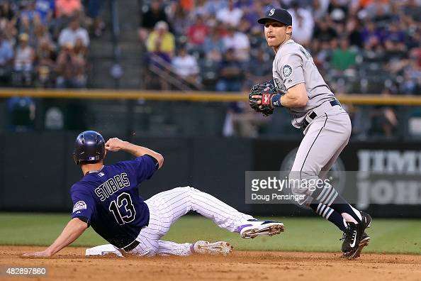Shortstop Brad Miller of the Seattle Mariners gets a force out on Drew Stubbs of the Colorado Rockies during interleague play at Coors Field on...