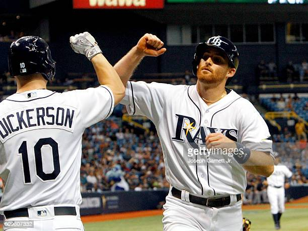 Shortstop Brad Miller of the Tampa Bay Rays celebrates with teammate Corey Dickerson after hitting a home run during the third inning of their game...