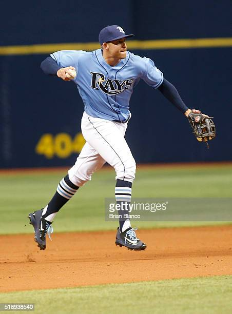 Shortstop Brad Miller of the Tampa Bay Rays fields the ground out by Kevin Pillar of the Toronto Blue Jays during the ninth inning of a game on April...