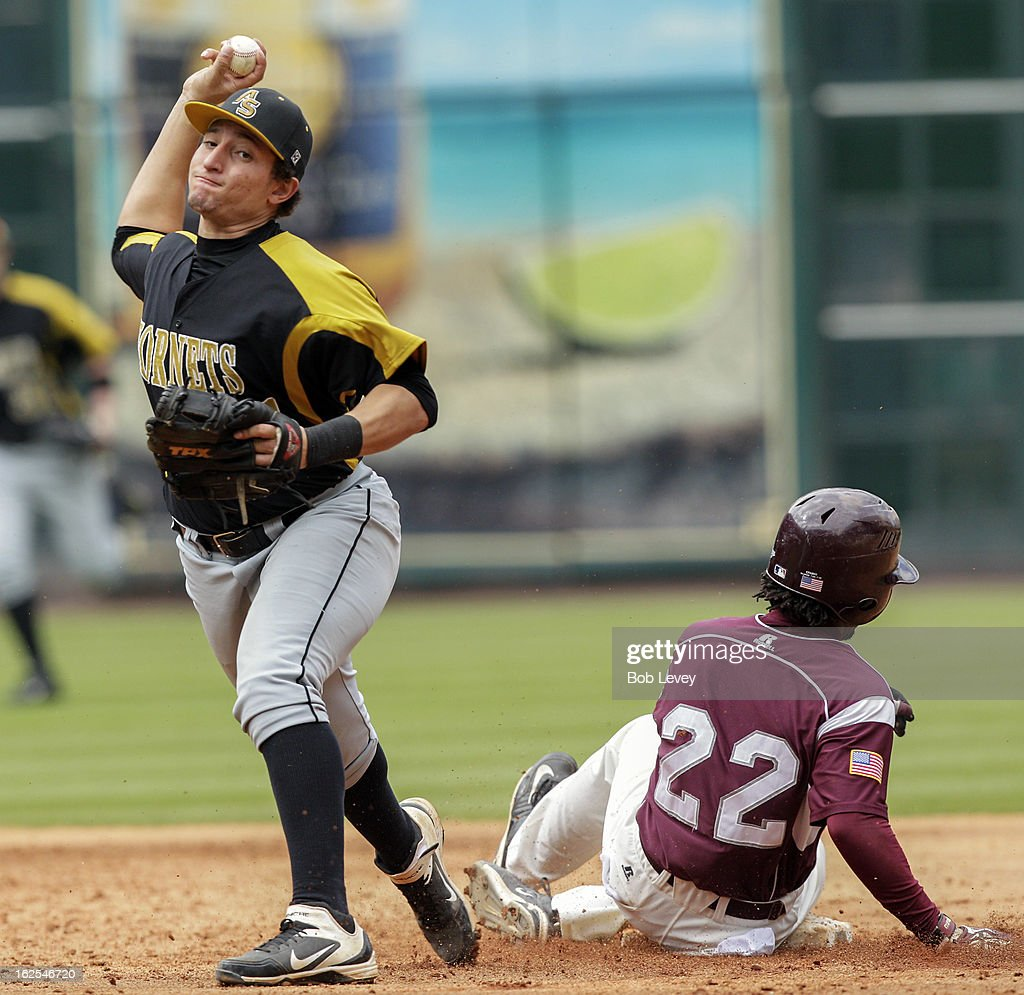Shortstop Branden Castro #21 of Alabama State throws to first base after forcing out Sebastian Stargell, Jr. of TSU during the 2013 Urban Invitational, February 24, 2013 in Houston, Texas.