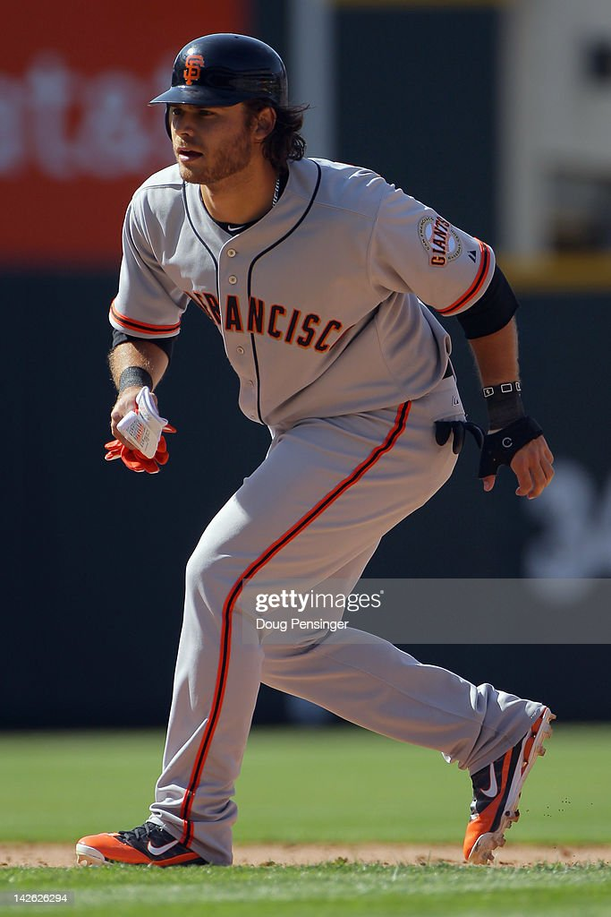 Shortstop <a gi-track='captionPersonalityLinkClicked' href=/galleries/search?phrase=Brandon+Crawford&family=editorial&specificpeople=5580312 ng-click='$event.stopPropagation()'>Brandon Crawford</a> #35 of the San Francisco Giants runs the bases against the Colorado Rockies on Opening Day at Coors Field on April 9, 2012 in Denver, Colorado. The Giants defeated the Rockies 7-0.