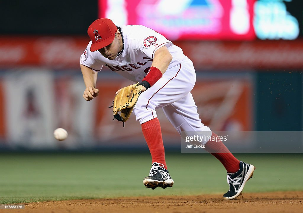 Shortstop <a gi-track='captionPersonalityLinkClicked' href=/galleries/search?phrase=Brendan+Harris&family=editorial&specificpeople=534816 ng-click='$event.stopPropagation()'>Brendan Harris</a> #20 of the Los Angeles Angels of Anaheim lunges but can't come up with a ball hit by Craig Gentry (not pictured) of the Texas Rangers in the second inning at Angel Stadium of Anaheim on April 24, 2013 in Anaheim, California.