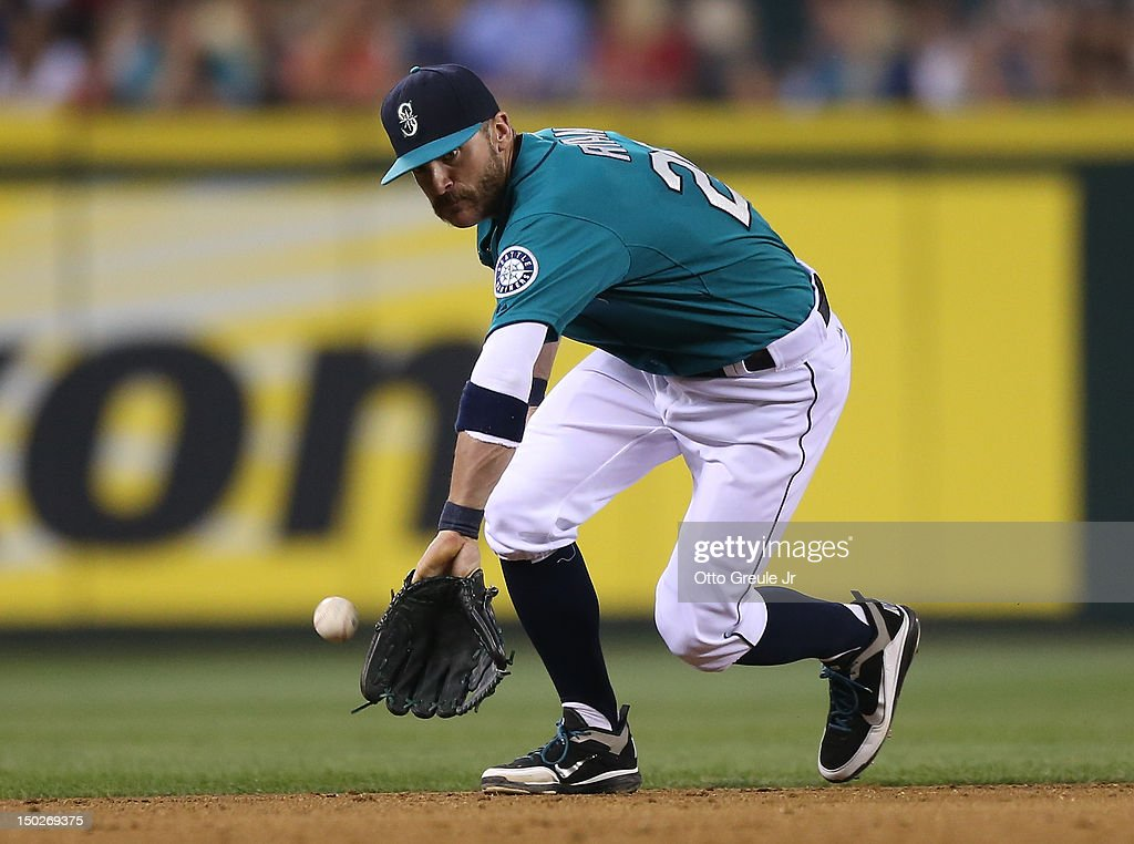 Shortstop <a gi-track='captionPersonalityLinkClicked' href=/galleries/search?phrase=Brendan+Ryan&family=editorial&specificpeople=835643 ng-click='$event.stopPropagation()'>Brendan Ryan</a> #26 of the Seattle Mariners just misses fielding a single by Desmond Jennings of the Tampa Bay Rays at Safeco Field on August 13, 2012 in Seattle, Washington.