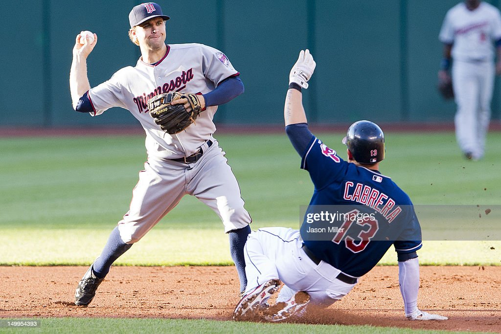 Shortstop Brian Dozier #20 of the Minnesota Twins throws to first as Asdrubal Cabrera #13 of the Cleveland Indians is out at second during the first inning at Progressive Field on August 7, 2012 in Cleveland, Ohio.
