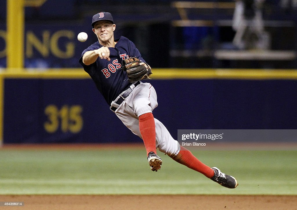 Shortstop <a gi-track='captionPersonalityLinkClicked' href=/galleries/search?phrase=Brock+Holt&family=editorial&specificpeople=9690034 ng-click='$event.stopPropagation()'>Brock Holt</a> #26 of the Boston Red Sox fields the single by Evan Longoria #3 of the Tampa Bay Rays during the eighth inning of a game on August 29, 2014 at Tropicana Field in St. Petersburg, Florida.