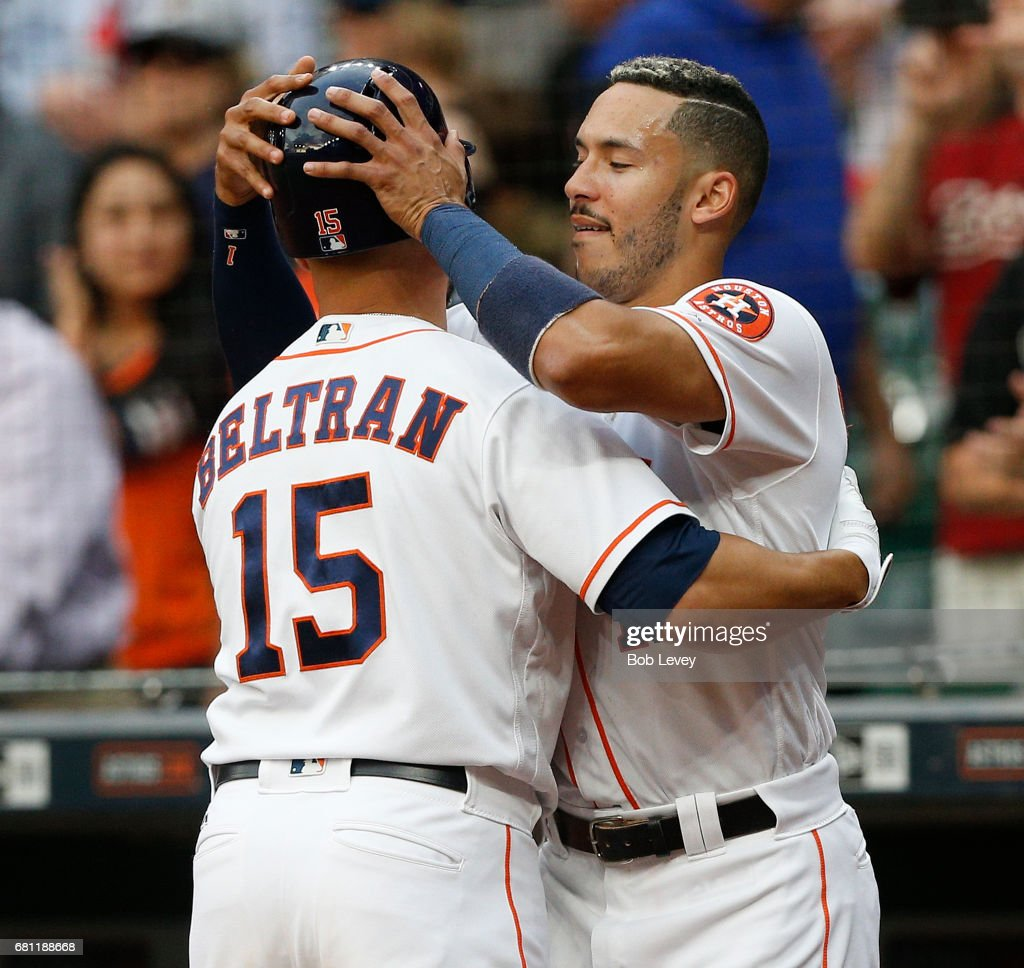 Shortstop Carlos Correa #1 of the Houston Astros congratulates designated hitter Carlos Beltran #15 after his first inning home run against the Atlanta Braves at Minute Maid Park on May 9, 2017 in Houston, Texas.