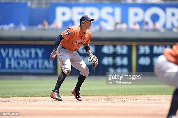 Shortstop Carlos Correa of the Houston Astros looks to home plate as the pitch is delivered during the game against the Kansas City Royals on July 26...
