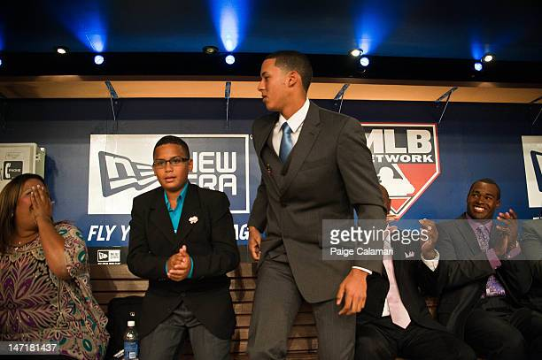 Shortstop Carlos Correa reacts to being drafted out of the Puerto Rico Baseball Academy by the Houston Astros with the top overall selection at the...