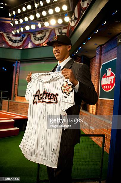 Shortstop Carlos Correa who was drafted out of the Puerto Rico Baseball Academy by the Houston Astros with the top overall selection poses with an...