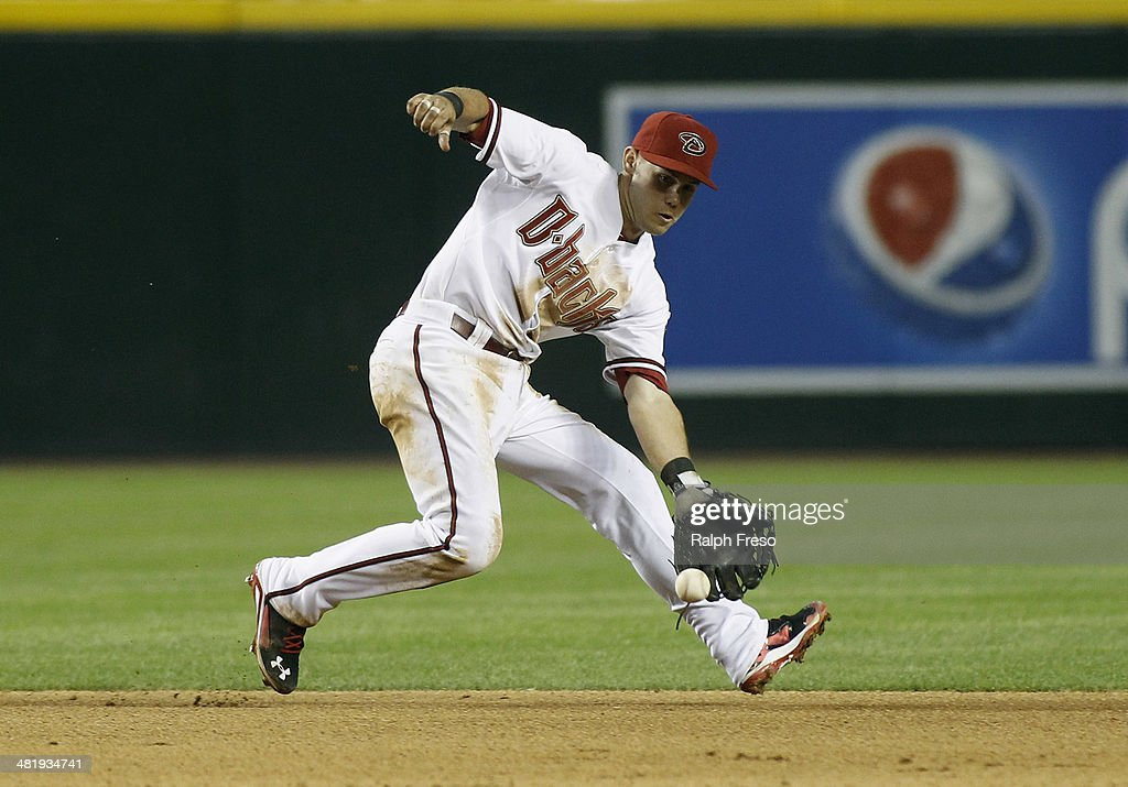 Shortstop Chris Owings #16 of the Arizona Diamondbacks fields a ground ball against the San Francisco Giants during the fifth inning of a MLB game at Chase Field on April 1, 2014 in Phoenix, Arizona.