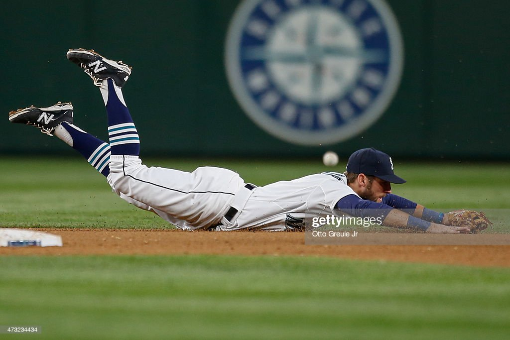 Shortstop <a gi-track='captionPersonalityLinkClicked' href=/galleries/search?phrase=Chris+Taylor+-+Baseball+Player&family=editorial&specificpeople=13511734 ng-click='$event.stopPropagation()'>Chris Taylor</a> #1 of the Seattle Mariners dives for a single off the bat of Will Venable of the San Diego Padres in the ninth inning at Safeco Field on May 13, 2015 in Seattle, Washington.