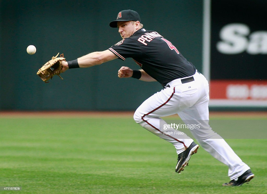 Shortstop Cliff Penningtgon #4 of the Arizona Diamondbacks reaches out in an attempt to field a base hit by A.J. Burnett #34 of the Pittsburgh Pirates during the third inning of a MLB game at Chase Field on April 25, 2015 in Phoenix, Arizona.
