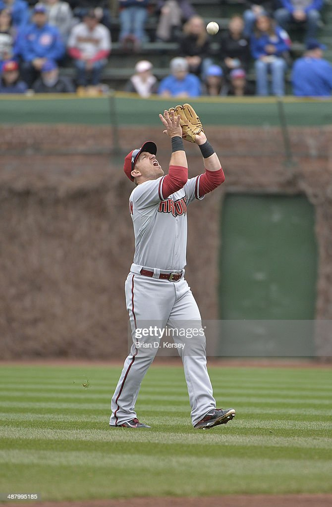 Shortstop Cliff Pennington of the Arizona Diamondbacks catches a pop up hit by Luis Valbuena of the Chicago Cubs during the second inning at Wrigley...