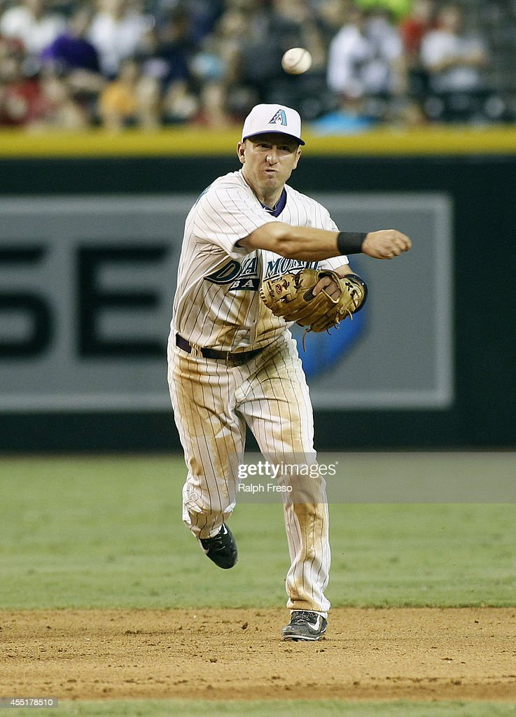 Shortstop Cliff Pennington of the Arizona Diamondbacks throws to first on a ground ball against the Colorado Rockies during the ninth inning of a MLB...