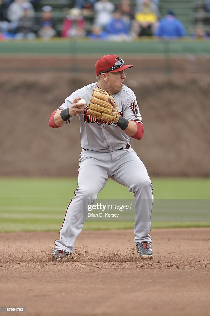 Shortstop Cliff Pennington of the Arizona Diamondbacks throws to first base during the sixth inning against the Chicago Cubs at Wrigley Field on...