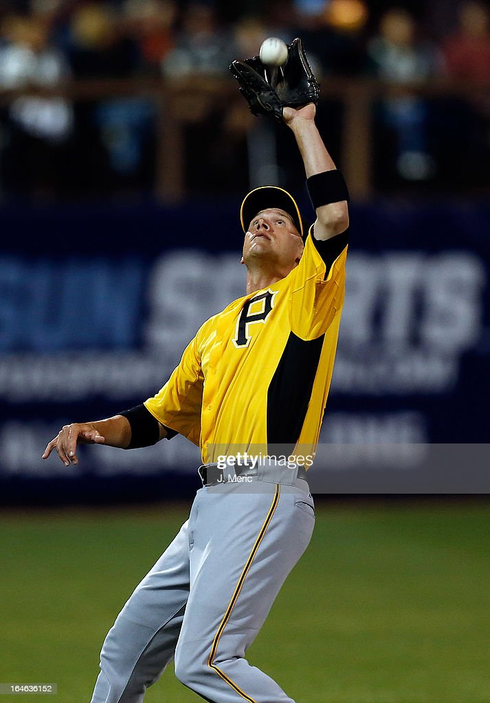 Shortstop <a gi-track='captionPersonalityLinkClicked' href=/galleries/search?phrase=Clint+Barmes&family=editorial&specificpeople=208223 ng-click='$event.stopPropagation()'>Clint Barmes</a> #12 of the Pittsburgh Pirates catches a fly ball against the Tampa Bay Rays during a Grapefruit League Spring Training Game at the Charlotte Sports Complex on March 25, 2013 in Port Charlotte, Florida.