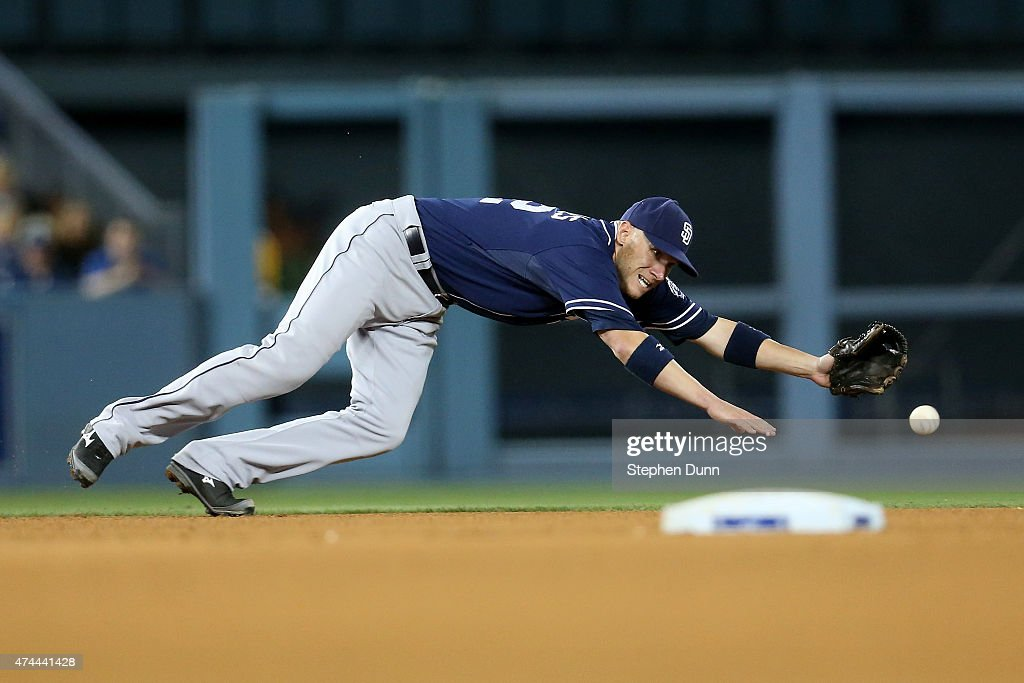 Shortstop Clint Barmes #12 of the San Diego Padres dives but can't reach a single hit by Justin Turner of the Los Angeles Dodgers in the fifth inning at Dodger Stadium on May 22, 2015 in Los Angeles, California.