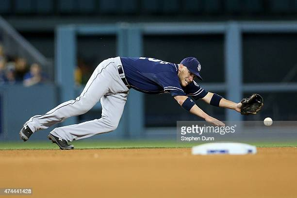 Shortstop Clint Barmes of the San Diego Padres dives but can't reach a single hit by Justin Turner of the Los Angeles Dodgers in the fifth inning at...