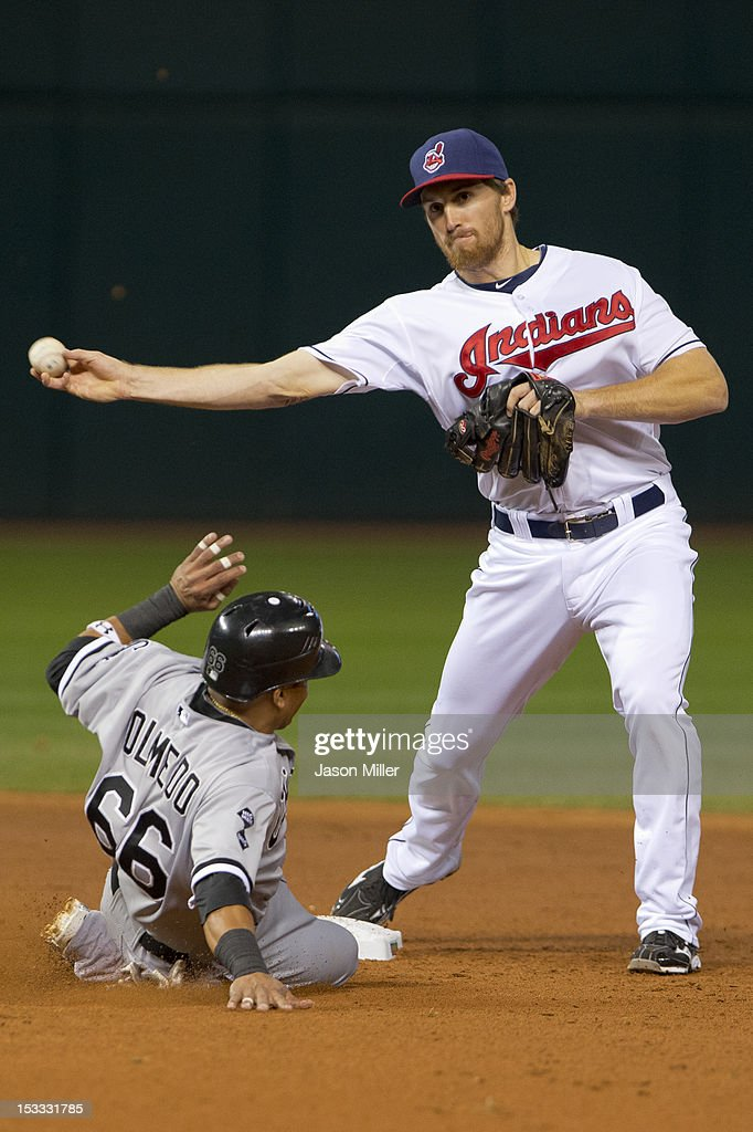 Shortstop Cord Phelps #46 of the Cleveland Indians throws to first base for a double play as Ray Olmedo #66 of the Chicago White Sox is out at second base during the third inning at Progressive Field on October 3, 2012 in Cleveland, Ohio.