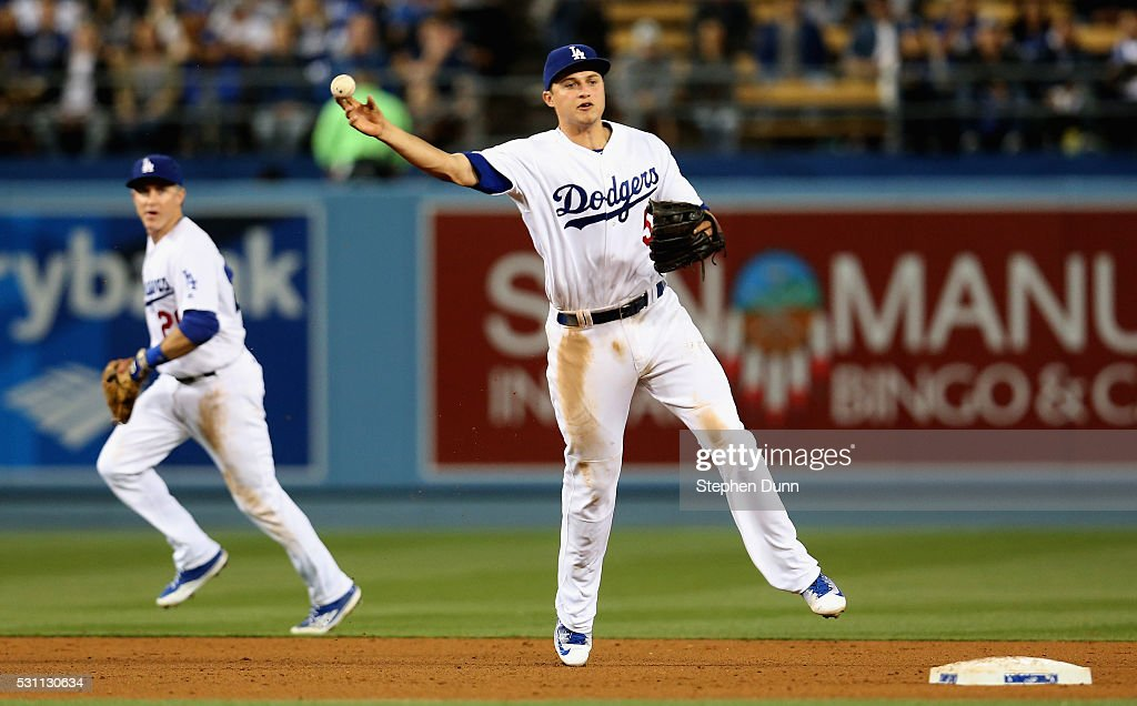 Shortstop Corey Seager #5 of the Los Angeles Dodgers throws to first to get Yoenis Cespedes of the New York Mets in the seventh inning at Dodger Stadium on May 12, 2016 in Los Angeles, California. The Dodgers won 5-0.