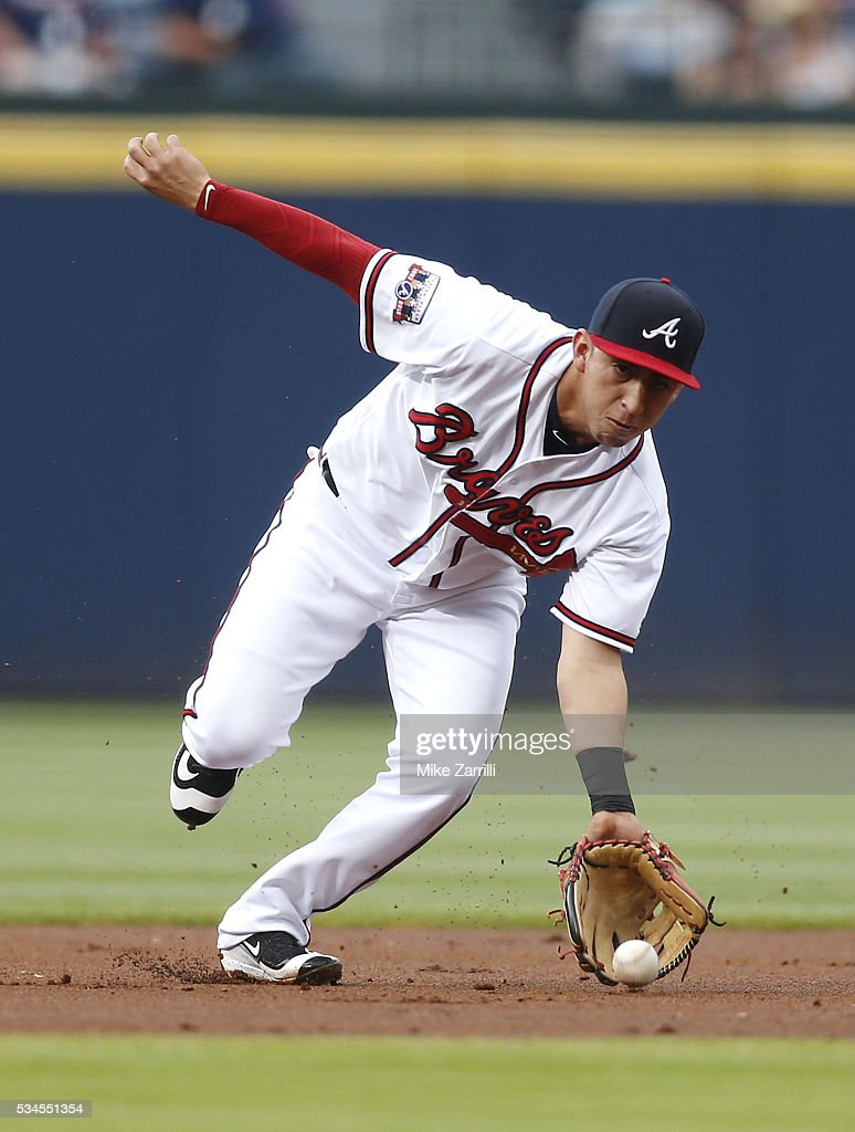 Shortstop Daniel Castro #14 of the Atlanta Braves makes a play in the first inning during the game against the Milwaukee Brewers at Turner Field on May 26, 2016 in Atlanta, Georgia.