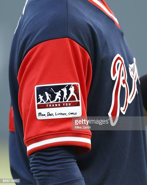 Shortstop Dansby Swanson of the Atlanta Braves thanks his family with a patch on his jersey during Players' Weekend before the game between the...
