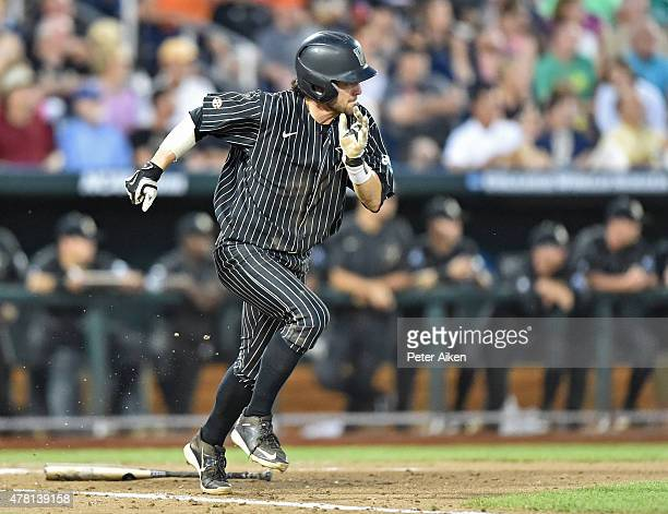 Shortstop Dansby Swanson of the Vanderbilt Commodores runs down the first base line against the Virginia Cavaliers in the sixth inning during game...