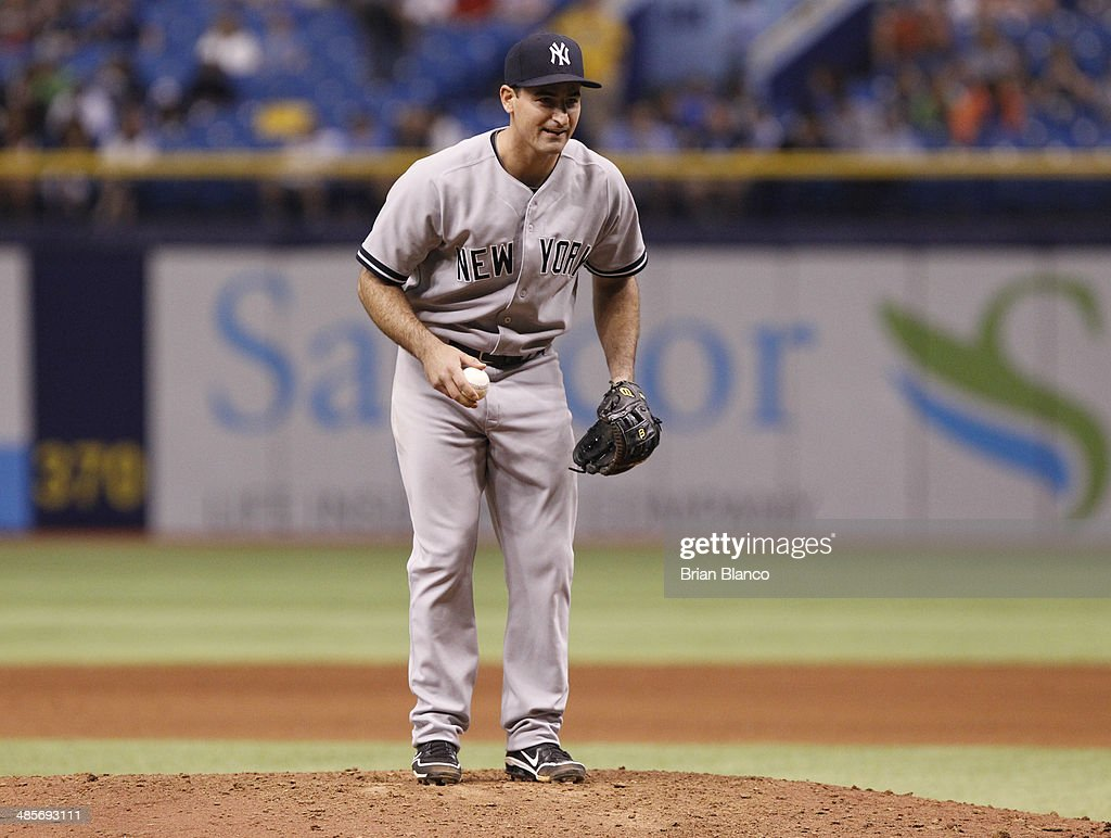 Shortstop Dean Anna #45 of the New York Yankees takes over pitching duties during the eighth inning of a game against the Tampa Bay Rays on April 19, 2014 at Tropicana Field in St. Petersburg, Florida.