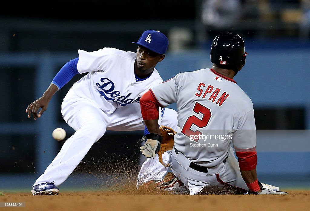 Shortstop <a gi-track='captionPersonalityLinkClicked' href=/galleries/search?phrase=Dee+Gordon&family=editorial&specificpeople=7091343 ng-click='$event.stopPropagation()'>Dee Gordon</a> #9 of the Los Angeles Dodgers takes the throw before tagging out <a gi-track='captionPersonalityLinkClicked' href=/galleries/search?phrase=Denard+Span&family=editorial&specificpeople=835844 ng-click='$event.stopPropagation()'>Denard Span</a> #2 of the Washington Nationals attempting to steal second for the third out of the top of the seventh inning at Dodger Stadium on May 15, 2013 in Los Angeles, California.