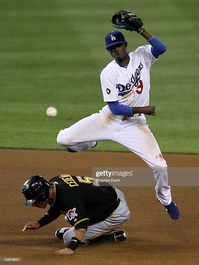 Shortstop Dee Gordon of the Los Angeles Dodgers throws to first after forcing out Ronny Cedeno of the Pittsburgh Pirates to complete a double play...