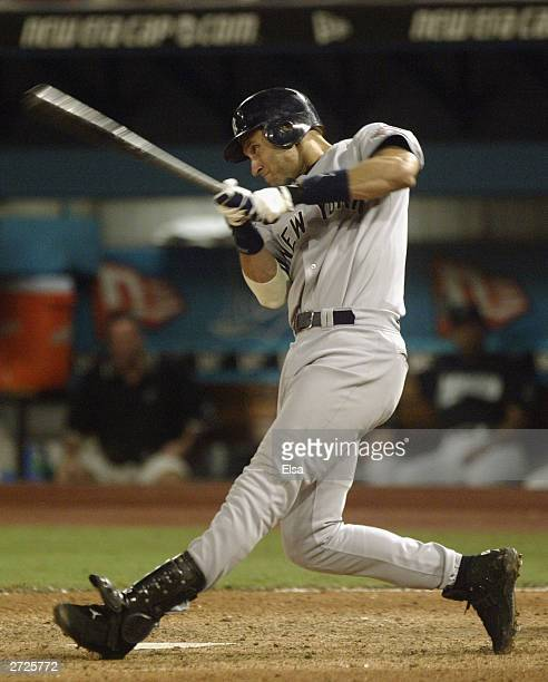 Shortstop Derek Jeter of the New York Yankees hits the ball during game four of the Major League Baseball World Series against the Florida Marlins on...