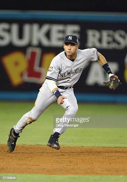 Shortstop Derek Jeter of the New York Yankees moves to his left to field a ball during game five of the Major League Baseball World Series against...
