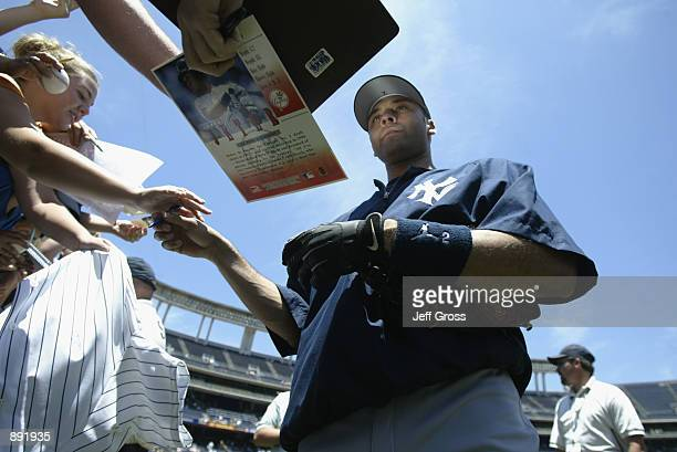 Shortstop Derek Jeter of the New York Yankees signs autographs before the MLB game against the San Diego Padres on June 23 2002 at Qualcomm Stadium...
