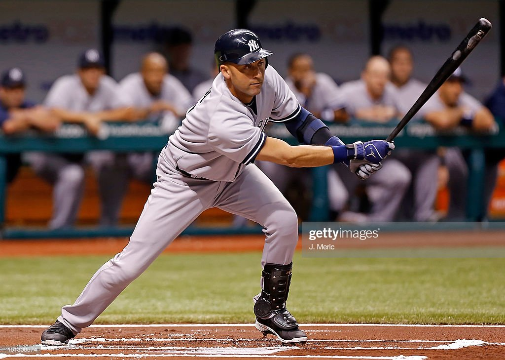 Shortstop <a gi-track='captionPersonalityLinkClicked' href=/galleries/search?phrase=Derek+Jeter&family=editorial&specificpeople=167125 ng-click='$event.stopPropagation()'>Derek Jeter</a> #2 of the New York Yankees singles against the Tampa Bay Rays during the game at Tropicana Field on September 5, 2012 in St. Petersburg, Florida.