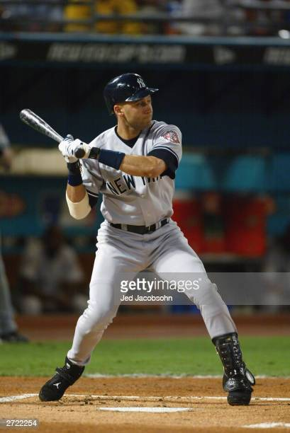 Shortstop Derek Jeter of the New York Yankees swings at a pitch against the Florida Marlins during game three of the Major League Baseball World...
