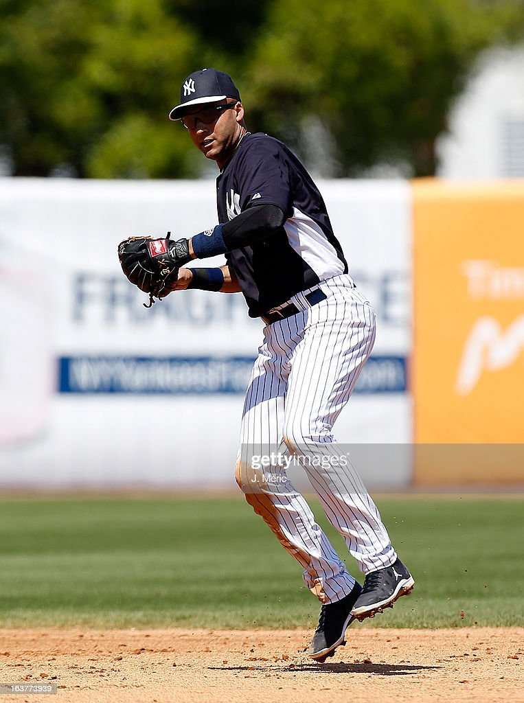 Shortstop Derek Jeter #2 of the New York Yankees throws over to first for an out against the Miami Marlins during a Grapefruit League Spring Training Game at George M. Steinbrenner Field on March 15, 2013 in Tampa, Florida.