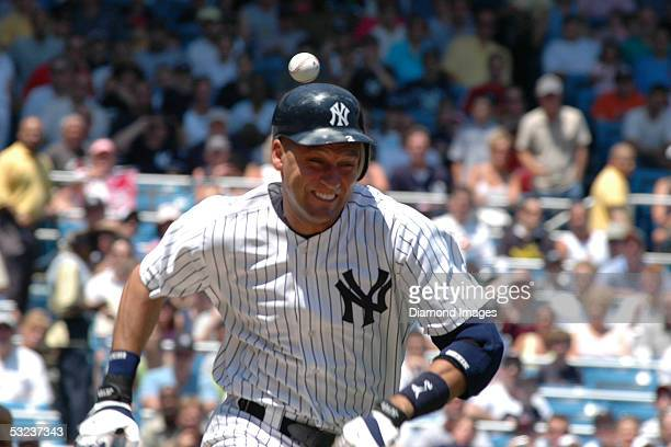 Shortstop Derek Jeter of the New York Yankees tries to outrun the throw from catcher Josh Bard of the Cleveland Indians during the first inning of a...