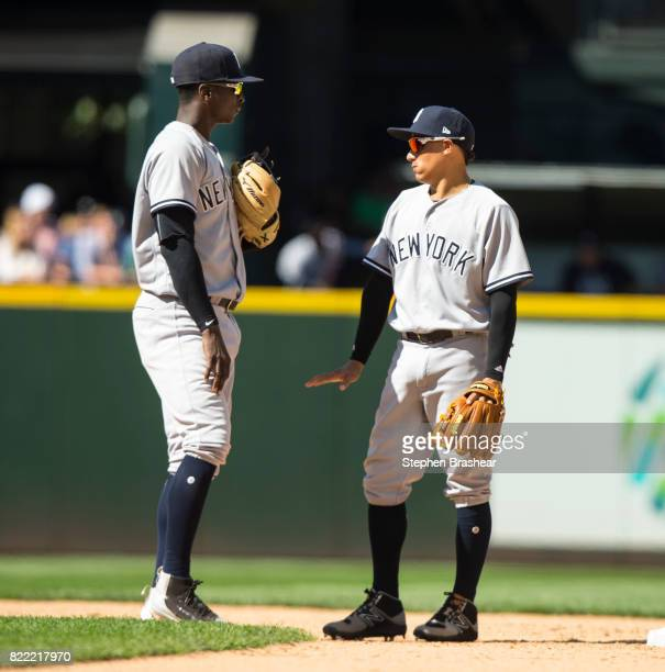 Shortstop Didi Gregorius and second baseman Ronald Torreyes of the New York Yankees talk on the field between inning during a game at Safeco Field on...