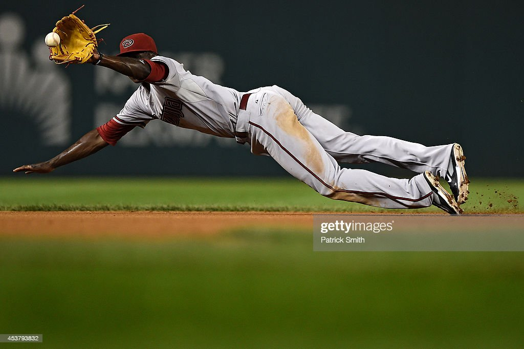 Shortstop <a gi-track='captionPersonalityLinkClicked' href=/galleries/search?phrase=Didi+Gregorius&family=editorial&specificpeople=8945889 ng-click='$event.stopPropagation()'>Didi Gregorius</a> #1 of the Arizona Diamondbacks makes a play on Wilson Ramos #40 of the Washington Nationals in the fifth inning at Nationals Park on August 18, 2014 in Washington, DC. The Washington Nationals won, 5-4, in the eleventh inning.