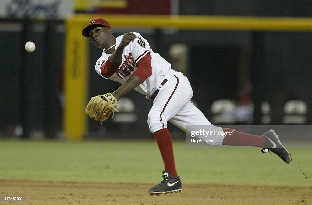 Shortstop <a gi-track='captionPersonalityLinkClicked' href=/galleries/search?phrase=Didi+Gregorius&family=editorial&specificpeople=8945889 ng-click='$event.stopPropagation()'>Didi Gregorius</a> #1 of the Arizona Diamondbacks makes an off balance throw to first on a ground ball against the Baltimore Orioles during the ninth inning of a MLB game at Chase Field on August 13, 2013 in Phoenix, Arizona.