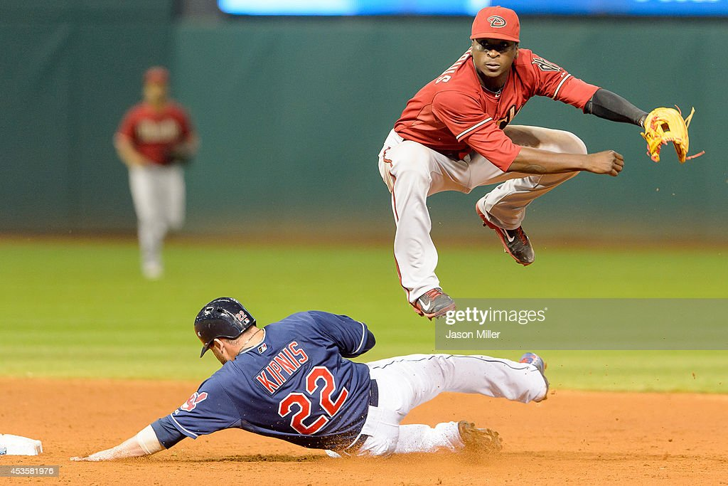 Shortstop Didi Gregorius #1 of the Arizona Diamondbacks throws out Mike Aviles #4 at first as Jason Kipnis #22 of the Cleveland Indians is out at second to end the tenth inning at Progressive Field during the second game of a double header on August 13, 2014 in Cleveland, Ohio.