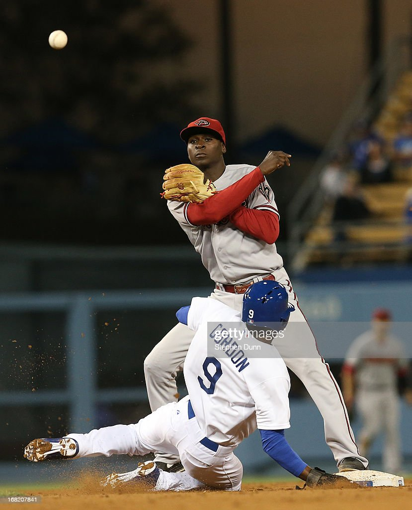 Shortstop Didi Gregorius #1 of the Arizona Diamondbacks throws to first after forcing out <a gi-track='captionPersonalityLinkClicked' href=/galleries/search?phrase=Dee+Gordon&family=editorial&specificpeople=7091343 ng-click='$event.stopPropagation()'>Dee Gordon</a> #9 of the Los Angeles Dodgers in the seventh inning at Dodger Stadium on May 6, 2013 in Los Angeles, California. Gregorius' throw went into the dugout for an error.