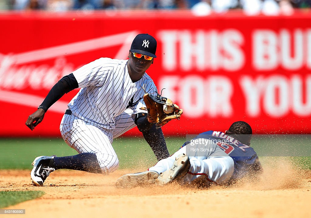 Shortstop <a gi-track='captionPersonalityLinkClicked' href=/galleries/search?phrase=Didi+Gregorius&family=editorial&specificpeople=8945889 ng-click='$event.stopPropagation()'>Didi Gregorius</a> #18 of the New York Yankees gets set to tag out <a gi-track='captionPersonalityLinkClicked' href=/galleries/search?phrase=Eduardo+Nunez&family=editorial&specificpeople=4900197 ng-click='$event.stopPropagation()'>Eduardo Nunez</a> #9 of the Minnesota Twins who attempted to steal second base in the sixth inning of a game at Yankee Stadium on June 26, 2016 in the Bronx borough of New York City.