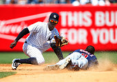Shortstop Didi Gregorius of the New York Yankees gets set to tag out Eduardo Nunez of the Minnesota Twins who attempted to steal second base in the...