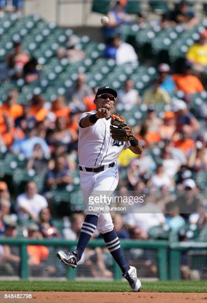 Shortstop Dixon Machado of the Detroit Tigers throws out Avisail Garcia of the Chicago White Sox at first base during the second inning at Comerica...