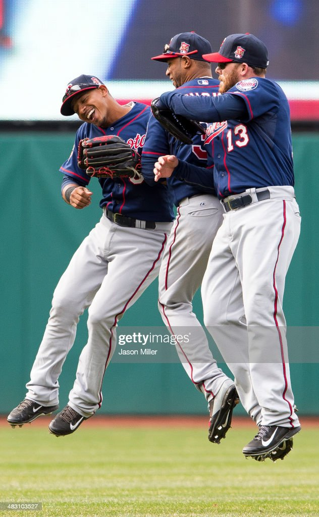 Shortstop <a gi-track='captionPersonalityLinkClicked' href=/galleries/search?phrase=Eduardo+Escobar&family=editorial&specificpeople=7522733 ng-click='$event.stopPropagation()'>Eduardo Escobar</a> #5 center fielder <a gi-track='captionPersonalityLinkClicked' href=/galleries/search?phrase=Aaron+Hicks&family=editorial&specificpeople=5471630 ng-click='$event.stopPropagation()'>Aaron Hicks</a> #32 and <a gi-track='captionPersonalityLinkClicked' href=/galleries/search?phrase=Jason+Kubel&family=editorial&specificpeople=575883 ng-click='$event.stopPropagation()'>Jason Kubel</a> #13 of the Minnesota Twins celebrate after the Twins defeated the against the Cleveland Indians at Progressive Field on April 6, 2014 in Cleveland, Ohio. The Twins defeated the Indians 10-7.