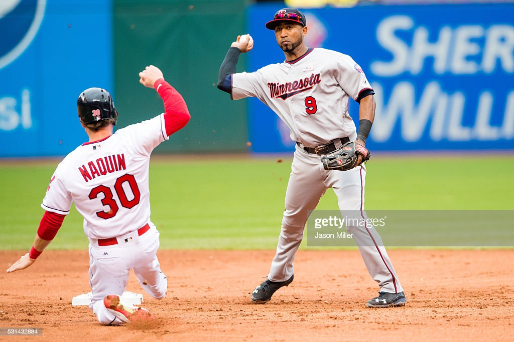 Shortstop Eduardo Nunez #9 of the Minnesota Twins throws out <a gi-track='captionPersonalityLinkClicked' href=/galleries/search?phrase=Carlos+Santana+-+Giocatore+di+baseball&family=editorial&specificpeople=11497843 ng-click='$event.stopPropagation()'>Carlos Santana</a> #41 at first as Tyler Naquin #30 of the Cleveland Indians is out at second for a double play to end the third inning at Progressive Field on May 14, 2016 in Cleveland, Ohio.